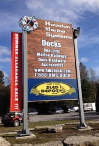 Houston Marine Systems and The Sled Depot sign on Highway 48, 4 KM west of Coboconk