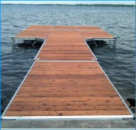 Aluminum standing dock with side sections, connected to shore stairs, as seen from a boat on Balsam Lake, near Coboconk, Ontario.
